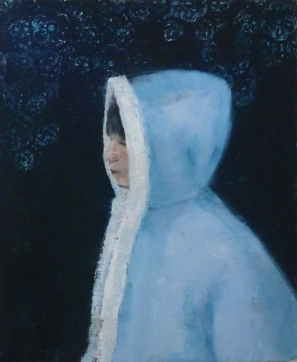 Young girl wearing blue winter parka with white faux fur trim