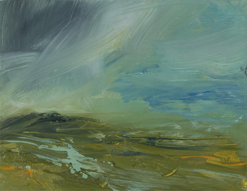 Yellowish clouds over heaving sea